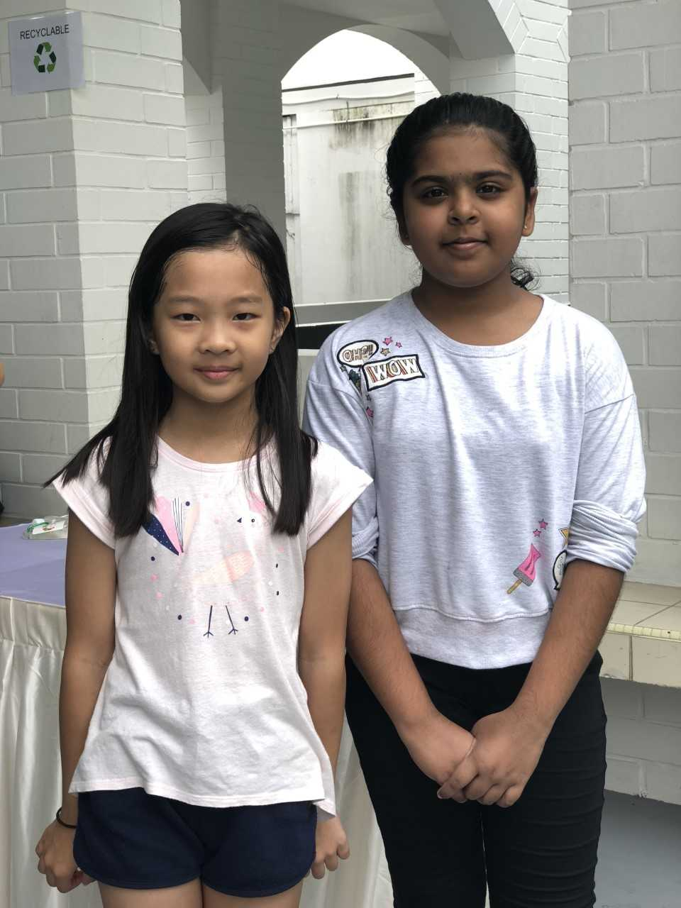 Kexin who came to volunteer all by herself made a new friend, Shreya Senthil while picking litter!