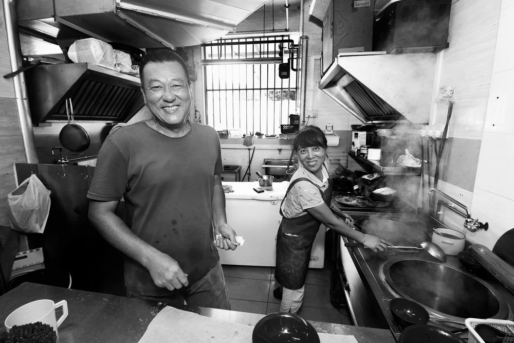 ALAN ONG  I'm always greeted by their lovely smiling faces when I head down to satisfy my wanton mee craving. Ah Long and his wife Zeng Hui opened their stall about two years ago and every morning before the sun rises, they would already be up preparing for the day's business. Running a stall next to the famed Tampines Round Market is not easy at all and their passion and positive mindset truly inspires me.