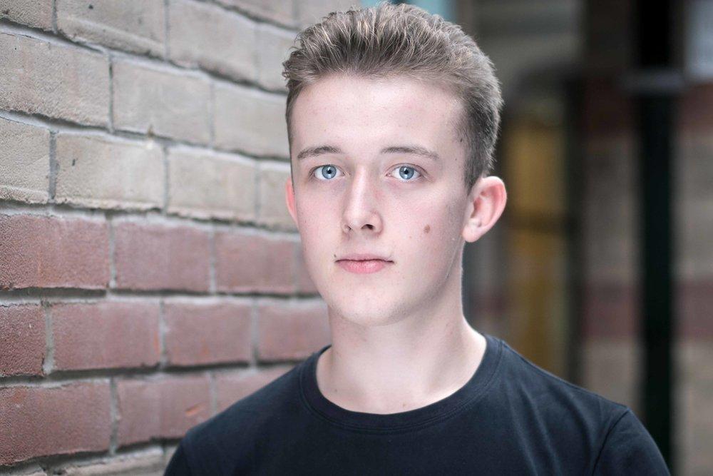 Actor headshot for Josh Ely.