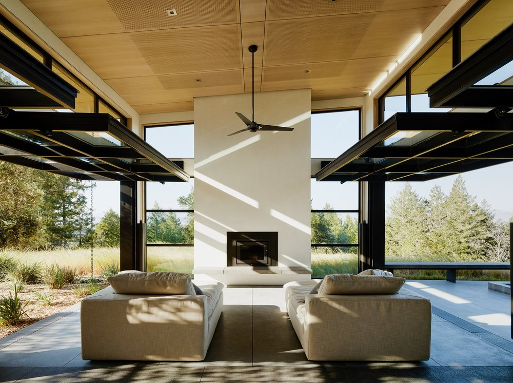 glazed-garage-doors-by-renlita-lift-up-to-completely-open-the-home-to-nature.jpg