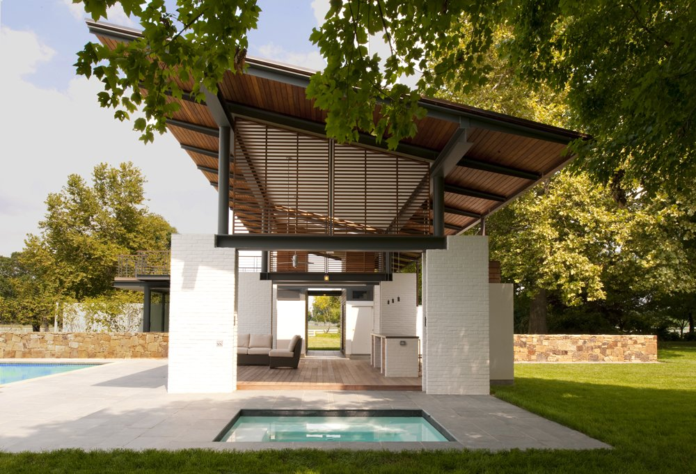 white-brick-piers-suspending-cantilevered-roof-by-pool-2.jpg