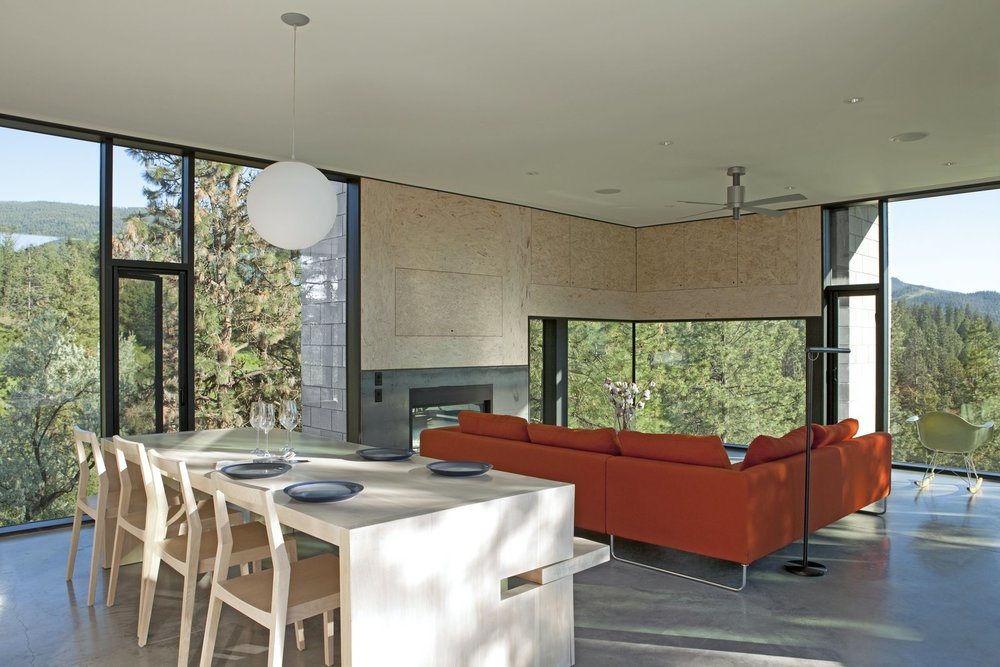 the-living-area-includes-a-red-canyon-sectional-by-bensen-and-a-pensi-ceiling-fan-by-modern-fan-company.jpg