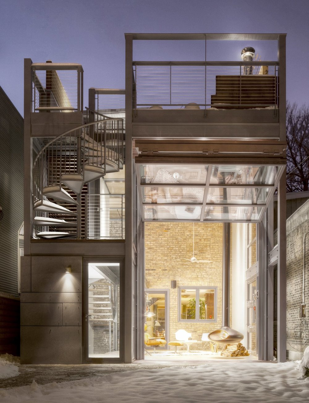 view-of-the-2-story-addition-with-the-hangar-door-open-providing-a-peak-to-the-historic-brick-wall-of-the-original-house-beyond.jpg