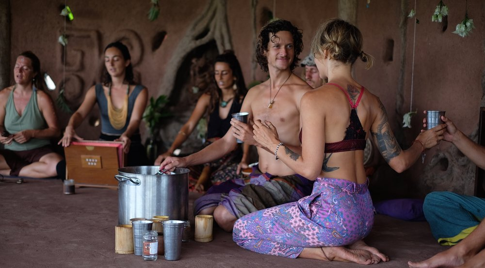 Sharing cacao drinks with kirtan before an ecstatic dance.