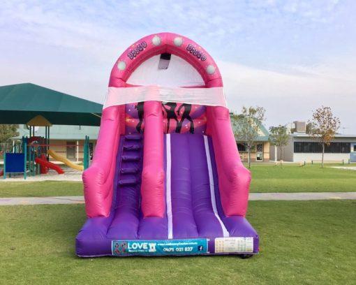 Pink Disco bouncy castle super slide hire