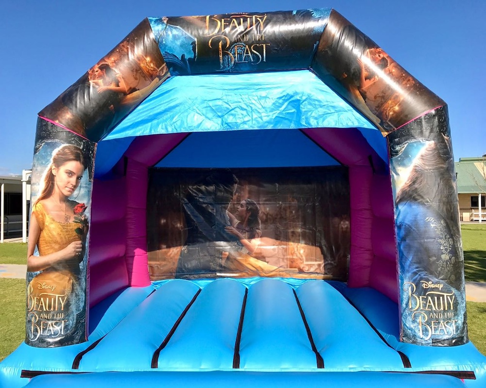 Beauty and the beast bouncy castle hire with slide Mandurah