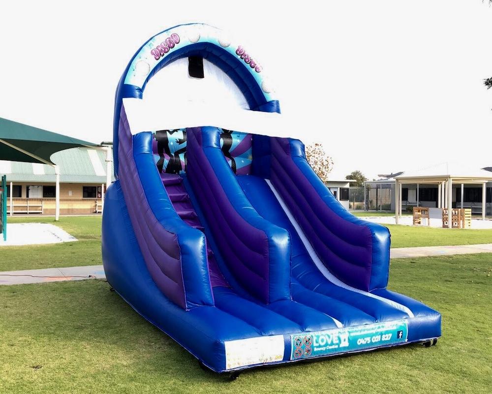 Blue Disco bouncy castle super slide hire 2