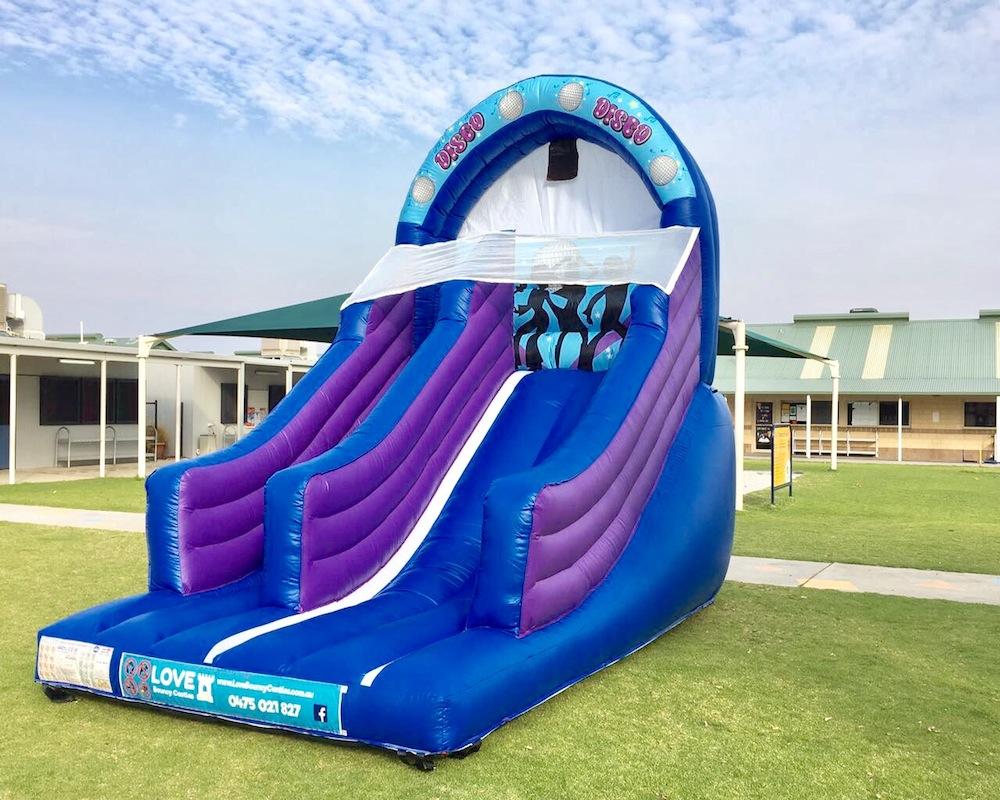 Blue Disco bouncy castle super slide hire 3