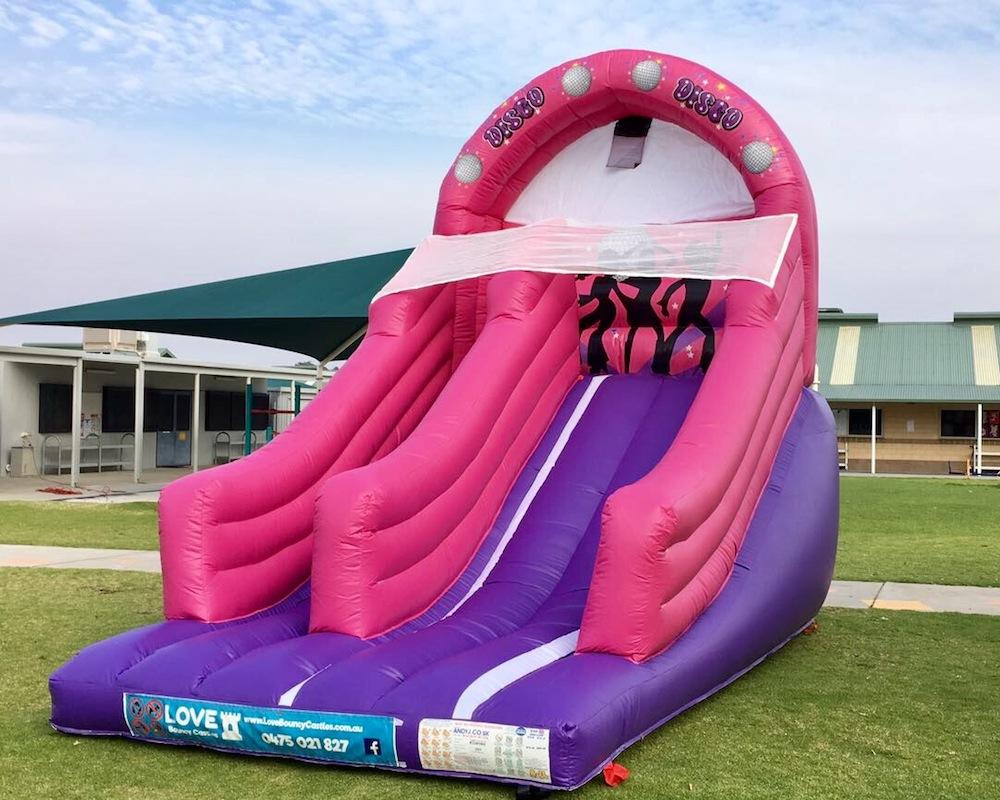 Pink Disco bouncy castle super slide hire 3