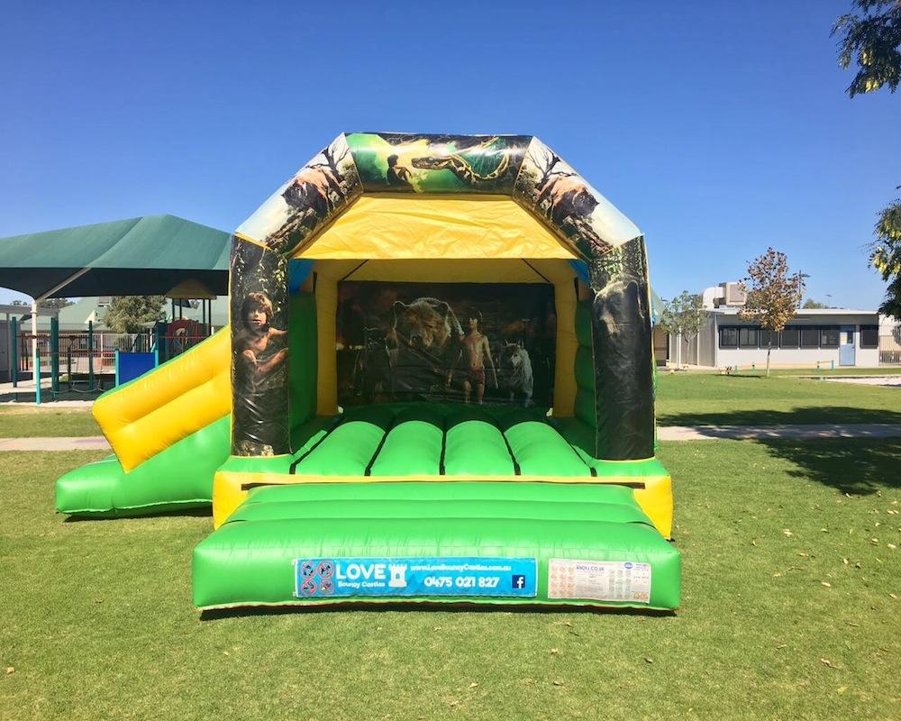Jungle Book bouncy castle hire with slide Baldivis