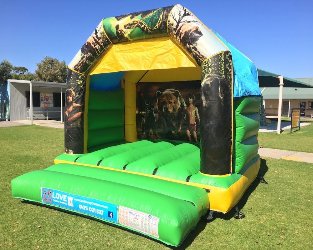 Jungle Book bouncy castle hire with Slide Rockingham