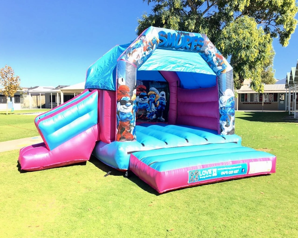 Smurfs bouncy castle hire with slide Rockingham
