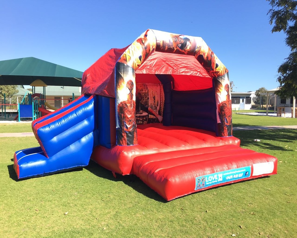 Spiderman bouncy castle hire with slide Rockingham