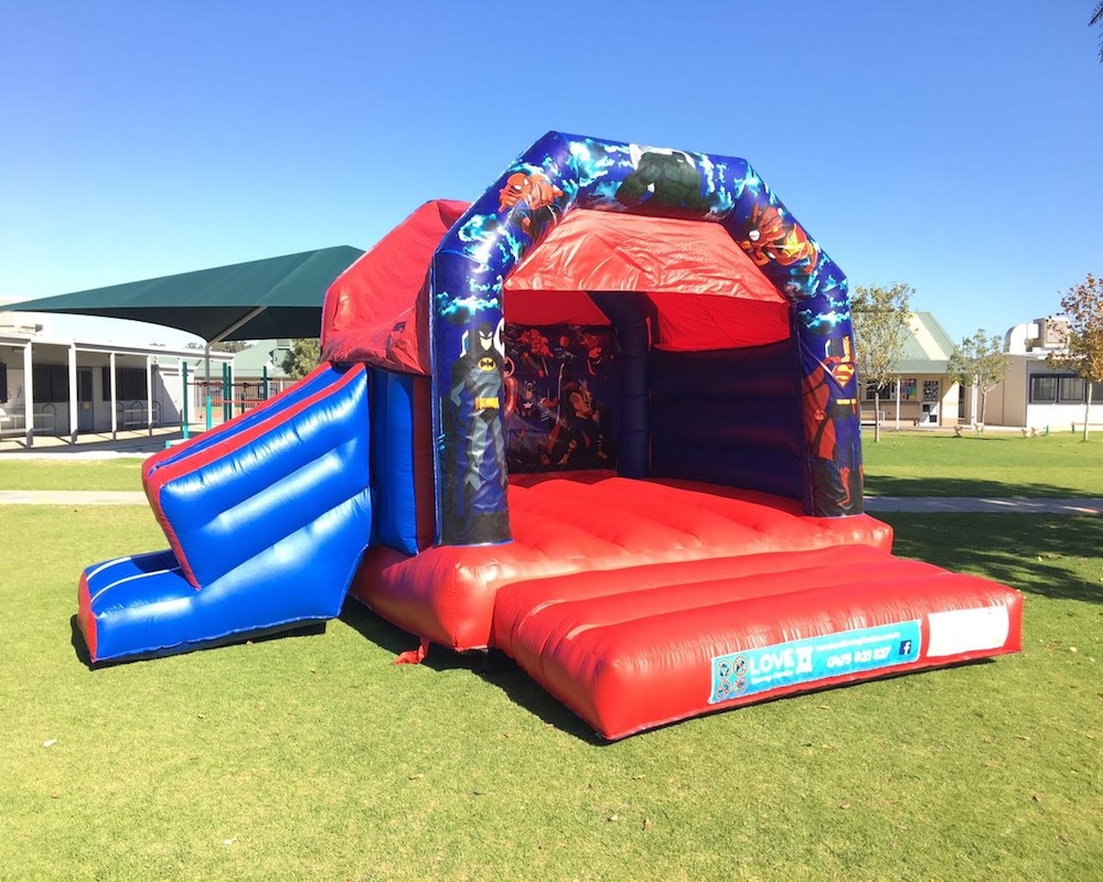 Super heros bouncy castle hire with slide Rockingham