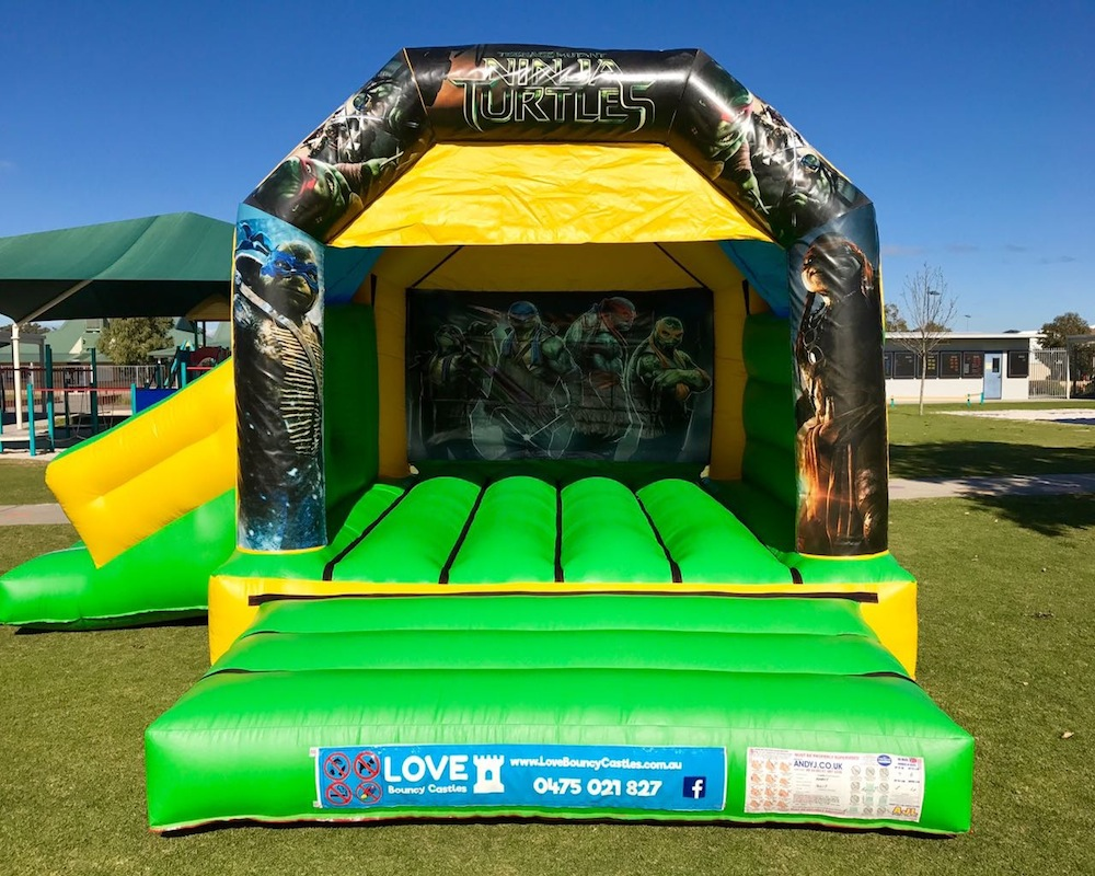 Teenage Mutant Ninja Turtles bouncy castle hire with slide Baldivis