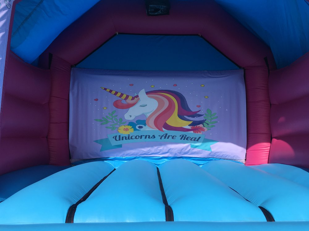 Unicorn bouncy castle hire with slide Mandurah