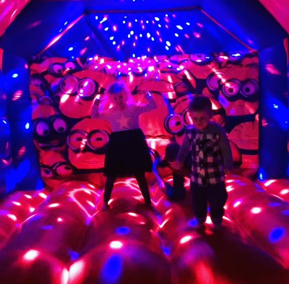 Copy of Kids Dancing Under The Disco Lights On A Minions Bouncy Castle In Perth, WA