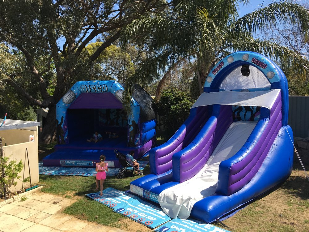 Copy of Double Party Hire. One Large Disco Bouncy Castle And One Inflatable Super Slide Set Up In Perth