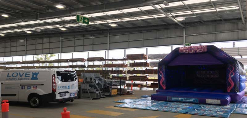 Adult Bouncy Castle Hire, Perth. Our regular client set-up at Bunnings Family Days!