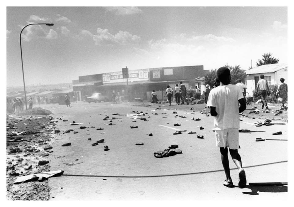 """March 25, 1990. Rent protest by Soweto residents ends in tear gas with protestors leaving their shoes behind as they flee from the scene."" Photo by Mbuzeni Zulu.  © Sowetan/Times Media"