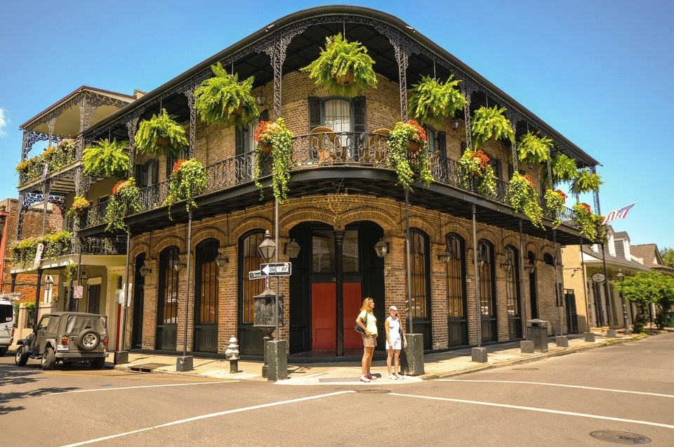A classic Creole Townhouse with brick façade and iron detailing. (French Quarter)
