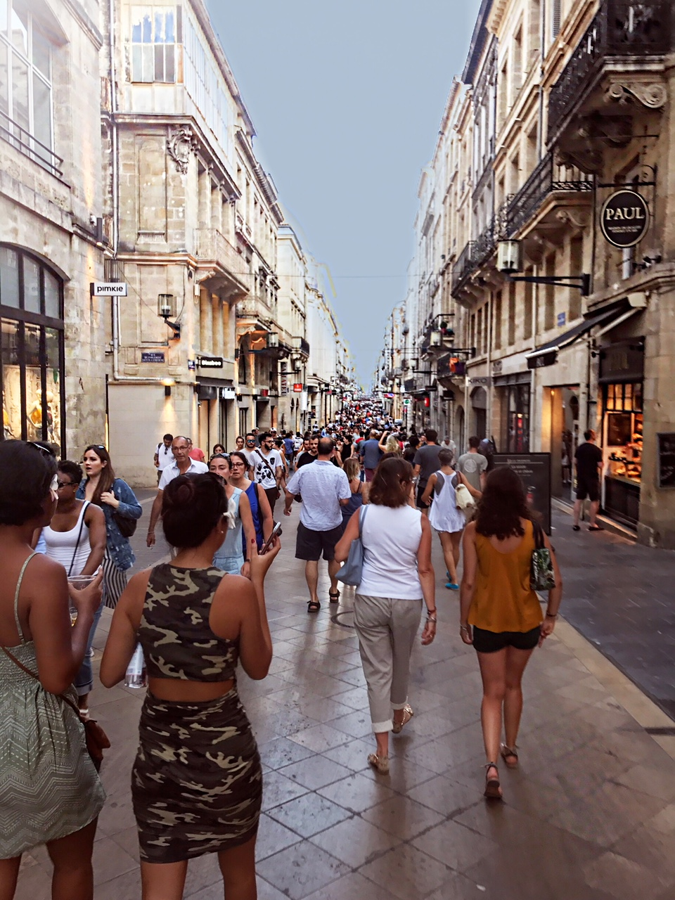 """Rue Sainte-Catherine - Oh la la the French sure take the term """"Shop till you Drop"""" seriously on this street. The Rue Sainte-Catherine in Bordeaux has been coined the longest pedestrian street in Europe. This street of 1.2 KM is the main shopping street of Bordeaux. It is best to start at the tip-top where the Intercontinental Grand Hotel is located and from there you will see the infamous Apple Store, once you see that you will find yourself strolling down to the Galleria Lafayette along with many, many and I mean many more stores. Ranging from cute petit boutiques to big name French brands such as, Etam, Pimkie and Undiz, and I cannot forget to add an endless amount of bakeries you'll pass along with chocolate stores."""
