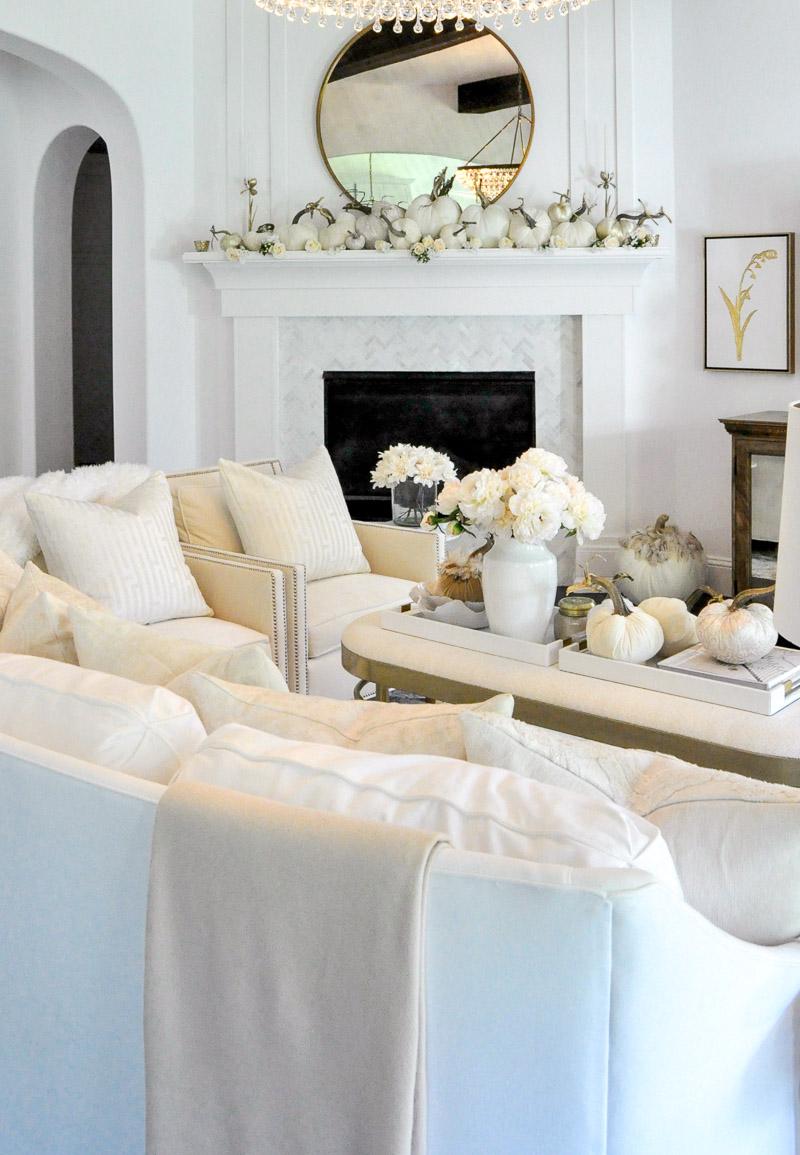 fall-living-room-white-velvet-pumpkins-fireplace-mantel-2.jpg