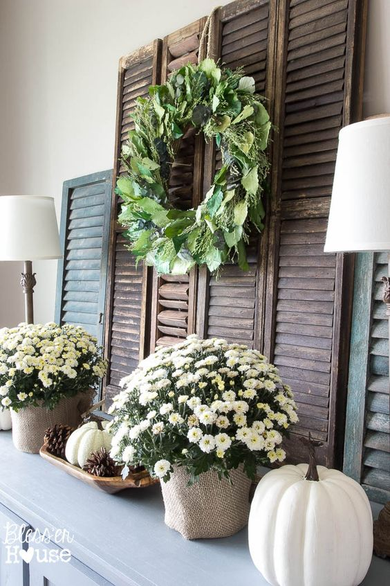 06-neutral-mantel-with-faux-pumpkins-and-potted-flowers.jpg