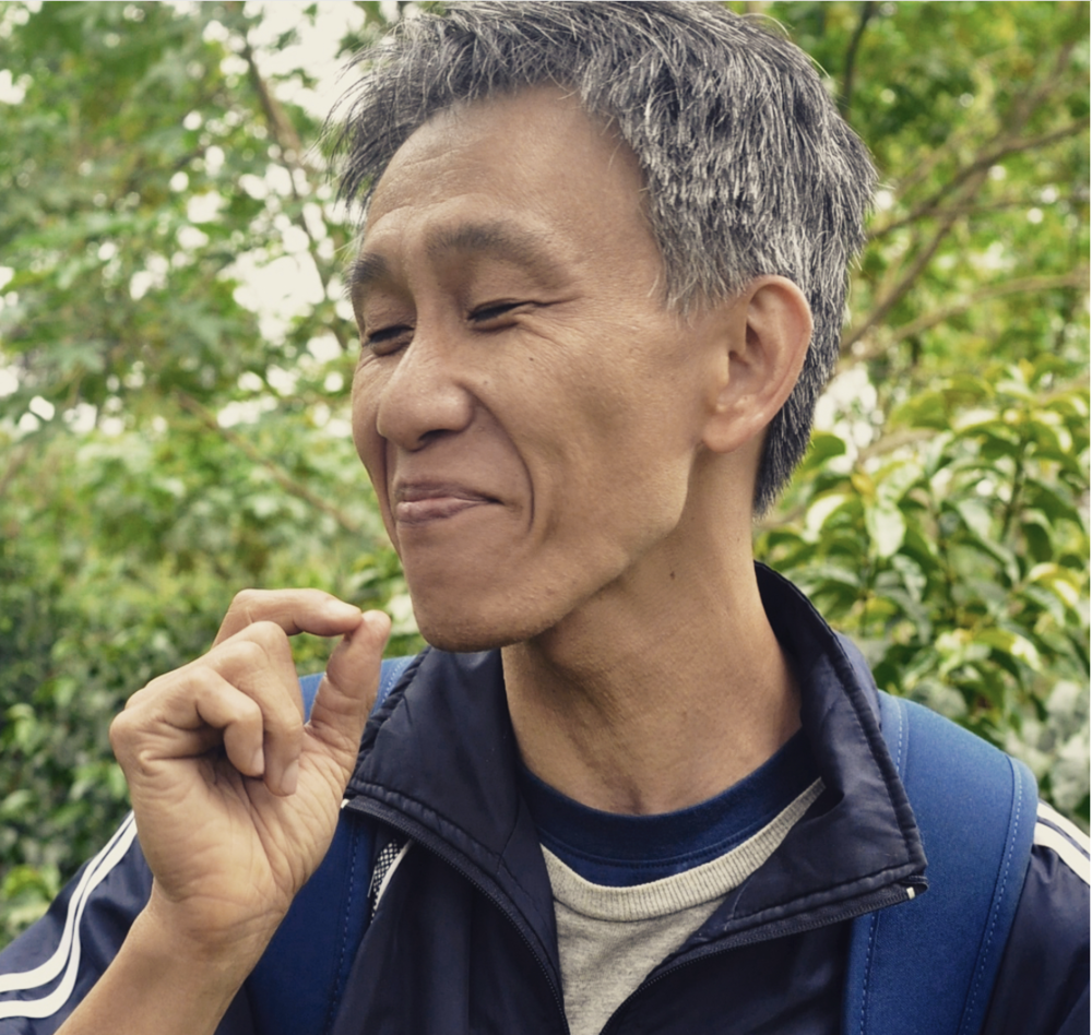 Sidney Kao tries the fruit of a Gesha coffee cherry for the first time.