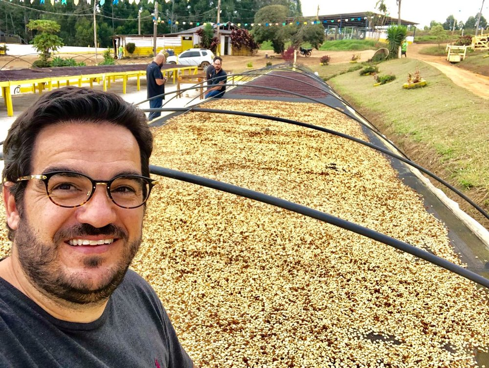 Luiz Paulo beside an African drying bed used for micro-lot washed coffees.