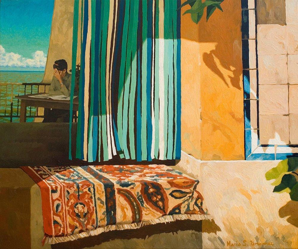 Multicoloured doormat and ocean
