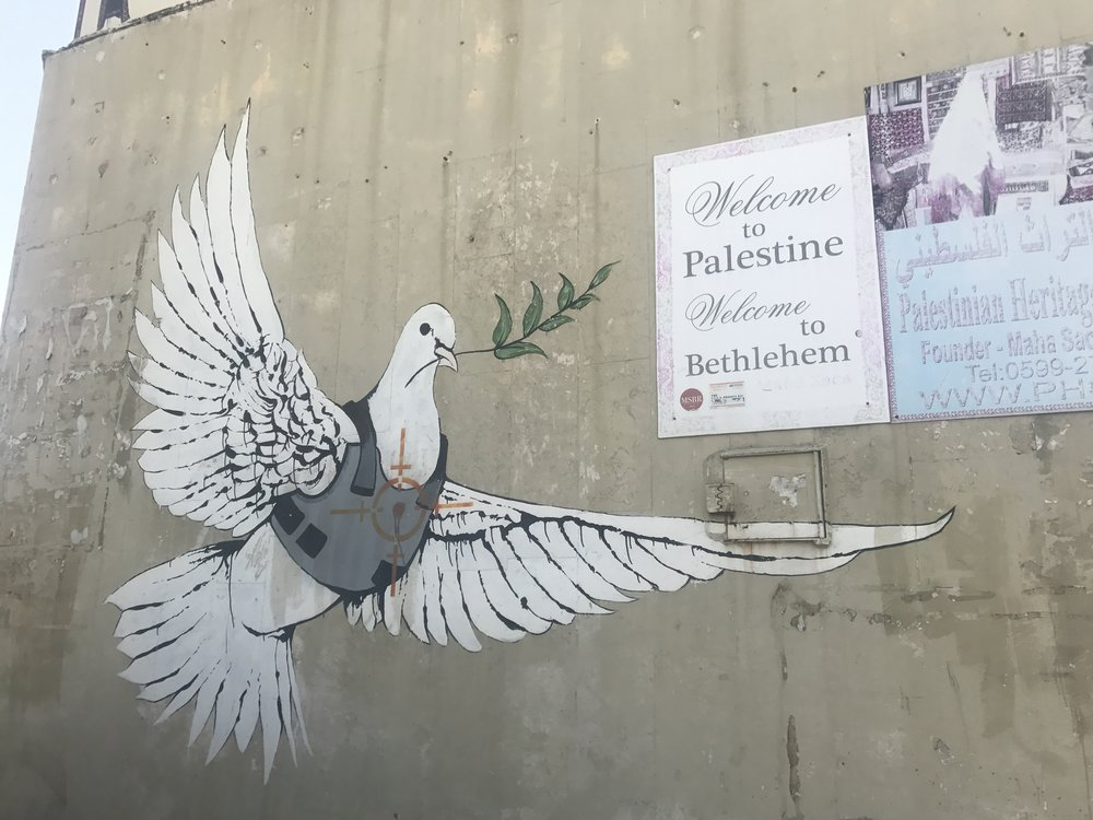 Banksy graffiti art in Bethlehem. Photo Credit: Samantha Manno, 2018.