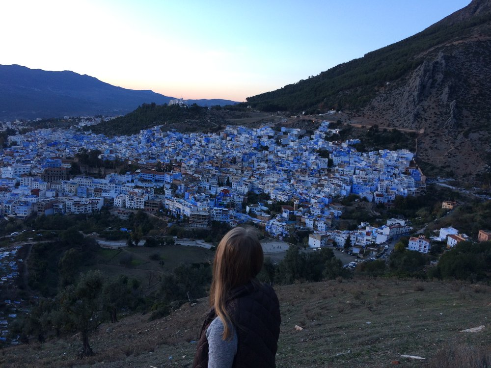 In Chefchaouen I spent a weekend walking all over with close friends and engaging with friendly shop owners who were so happy to speak with me in Arabic. We walked up one of the surrounding mountains to visit the Spanish mosque at sunset. Looking out over the city I was also looking back on my experience in Morocco. I remember feeling so grateful for close friendships and the mountains in those moments. After spending time in this beautiful blue city I felt so ready to put my Arabic knowledge into practice and to explore more places, while remembering to more carefully appreciate sunsets and the people around me. Photo credit: Beaton, 2018.