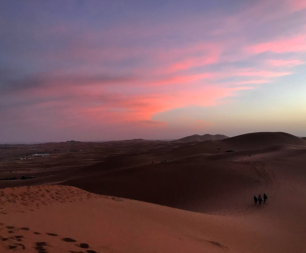 The Sahara desert is the most beautiful place I have been to. It takes several hours on a stuffy bus followed by an hour-long bumpy camel to get to the heart of the desert. This picture was taken while the sun was setting and shows a contrast between night and day perfectly split in the middle. Photo credit: Rehman, 2018