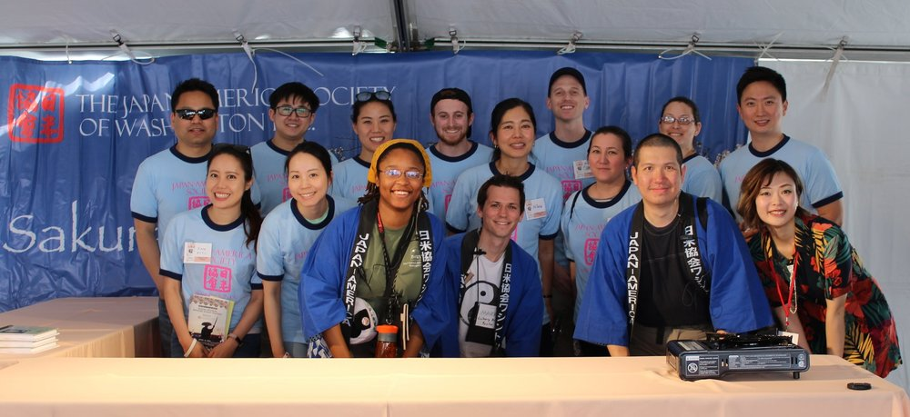 Posing with her staff team and volunteers in the Culinary Arts Pavilion at the National Cherry Blossom Festival. Photo credit: Long-HIllie, 2018