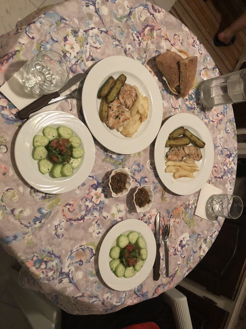 Typical Moroccan dinner, including chicken, potatoes, and cooked zucchini with a small salad. Photo credit: Szabo, 2018