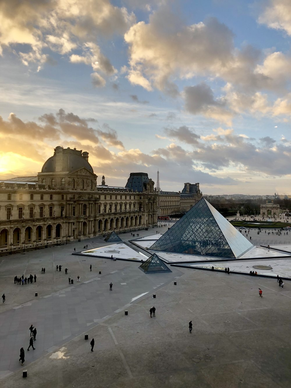 Paris at dusk, seen from inside the Louvre. Photo Credit: Jaycee Miller