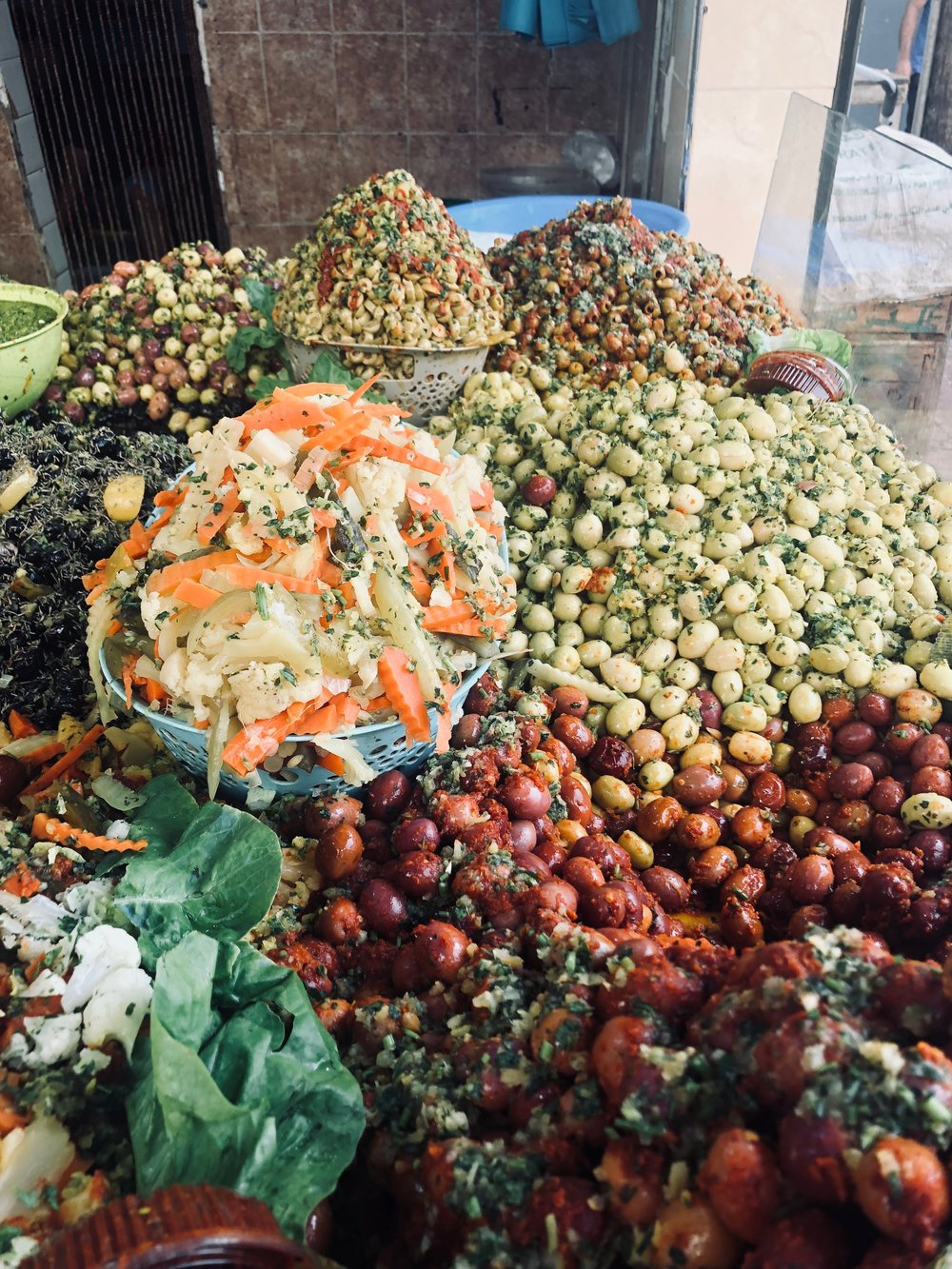 Mountains of olives at the souq. Photo credit: J. Miller, Fall 2018