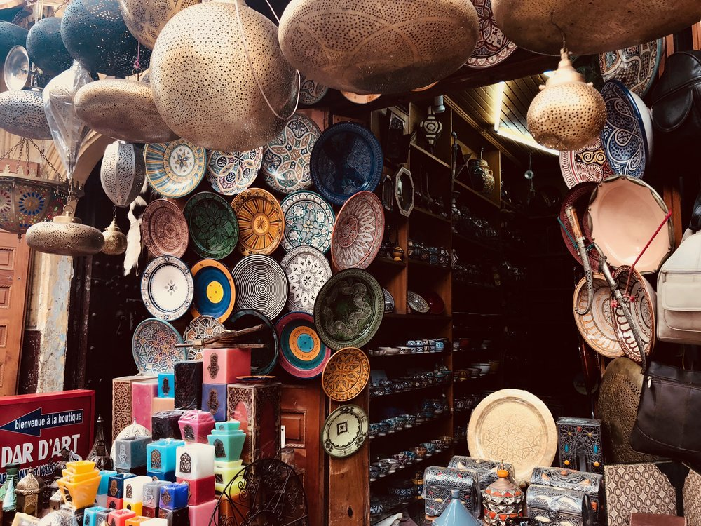 Stall of bowls, lamps, and tajines for sale in the medina. Photo credit: J. Miller, Fall 2018