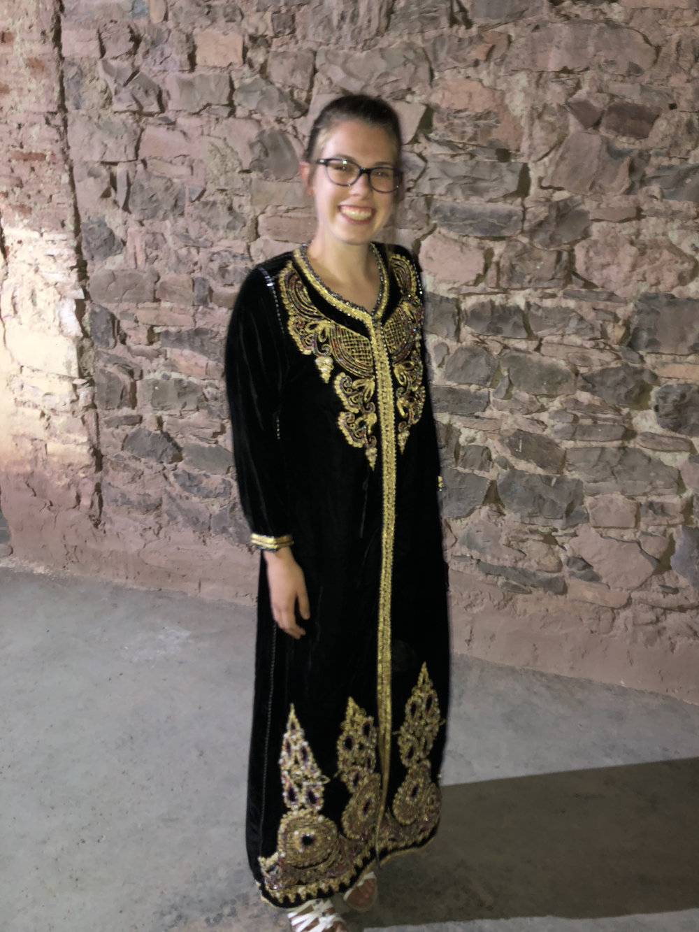 I had the privilege of wearing a traditional djellaba provided by the Sheikh's family for dancing and festivities on our final night in the community. Photo Credit: G. Szabo, Fall 2018