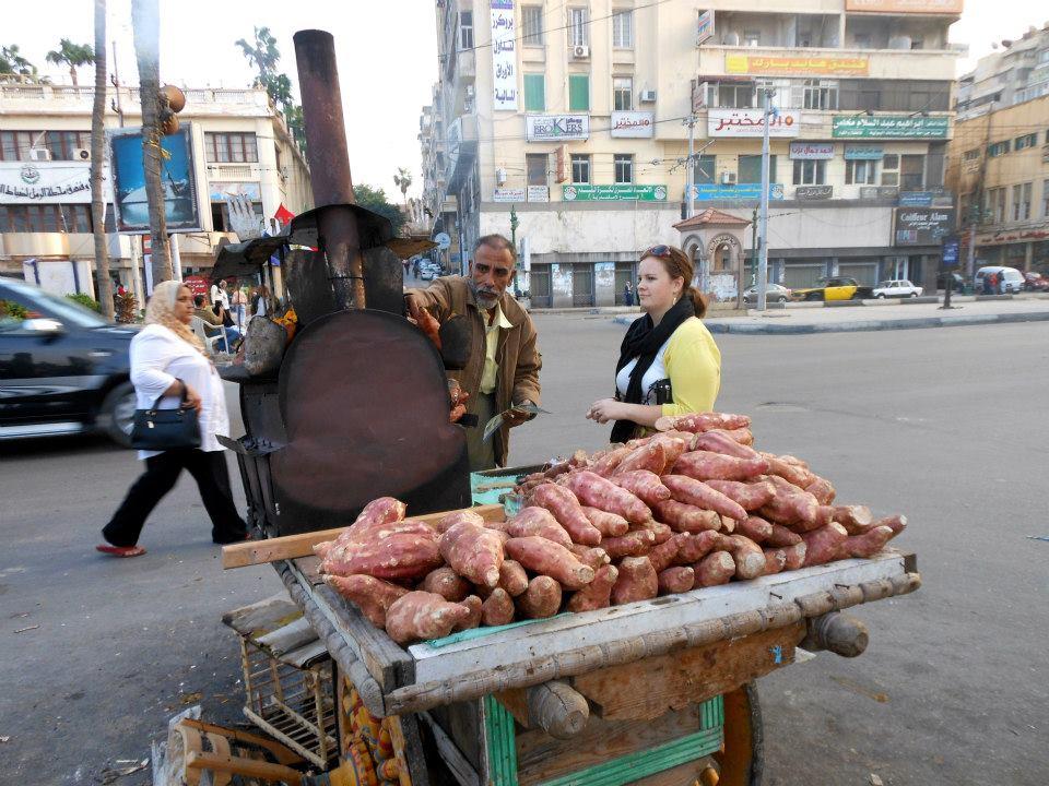 Purchasing a roast sweet potato in Alexandria, Egypt. Photo Credit: C. Litten, Spring 2012