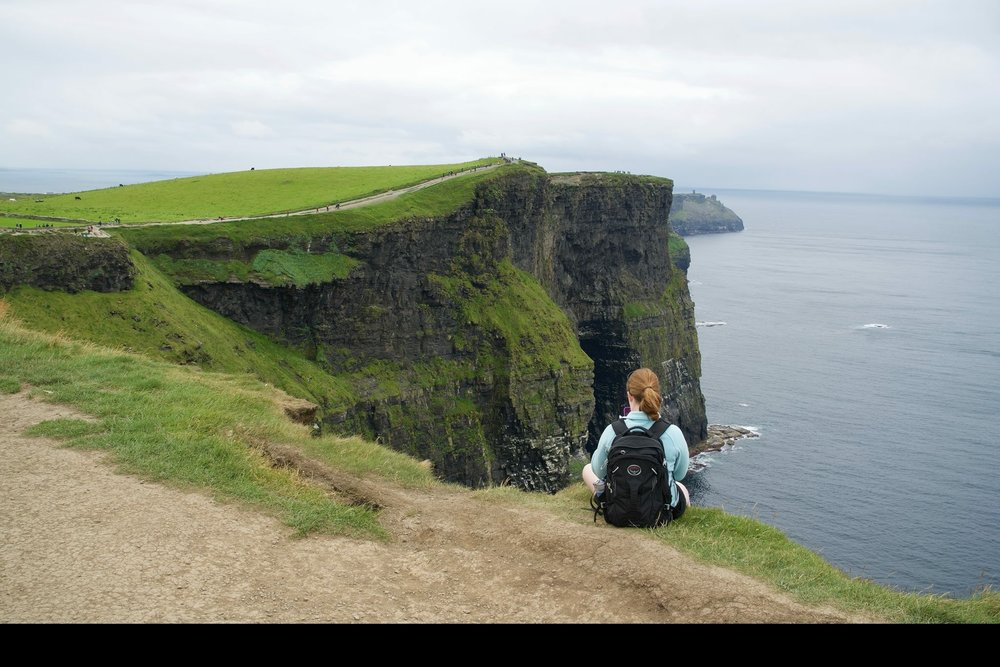 I absolutely love to travel and have been to Canada, Ireland, Northern Ireland, Scotland, England, France, The Netherlands, Denmark, Germany, and Vietnam. My mother is an immigrant from Ireland and in this photo I am sitting on the Cliffs of Moher on the western coast of Ireland in 2016. After I graduated high school I took a backpacking trip through Europe and visiting Ireland was one of its highlights. I chose to study abroad in the Arab world because the Arabic department at my university largely focuses on Modern Standard Arabic and writing rather than speaking, so I know I need to travel to the Arab world in order to learn a dialect and how to communicate with people. In my opinion, there is no better way to do this than complete immersion for an extended period of time and staying with a host family. I also look forward to exploring a new region of the world. Photo credit: Tenney, 2016.