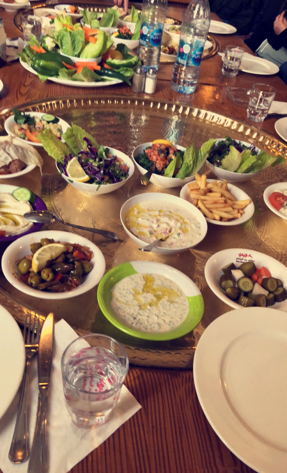 This was a traditional Jordanian Lunch at Reem Al-Bawadi Restaurant. We went with all of the students, professors and faculty at AMIDEAST Amman. There were three courses. Pictured here is the appetizer with tabouleh, hummus, fries, grape leaves, and vegetables. Photo credit: Arguin, 2019