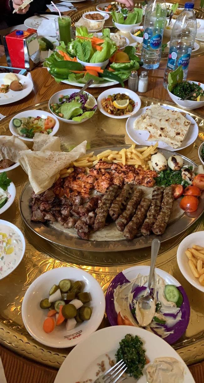 More of our lunch at Reem Al-Bawadi Restaurant! The main course had french fries, grilled veggies and different types of meat. I was really happy to see that I loved the different meats and even the grilled veggies - something new for me! Photo credit: Arguin, 2019