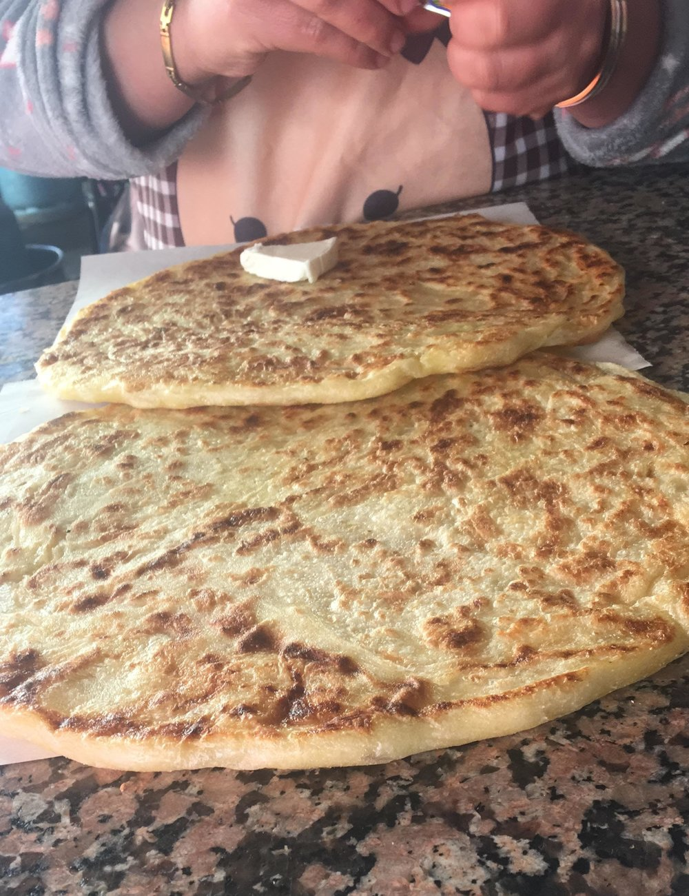 Mmm… msemen. This typical Moroccan breakfast bread, usually served with oils, honey, cheese, or stuffed with spices or meat. The dough is kneaded, stretched, and layered so that when it is cooked on a griddle it becomes a flakey, doughy, delicious pancake-like treat. Photo Credit: L. Fisher, Spring 2019