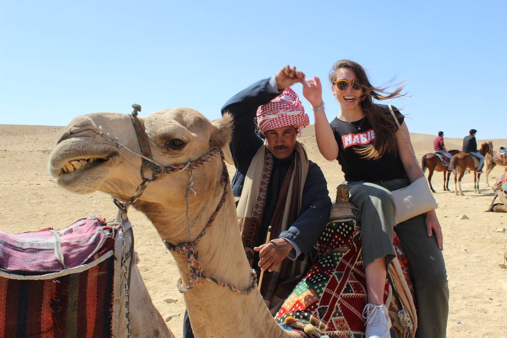Riding camels at the pyramids. Photo credit: Arguin, 2019