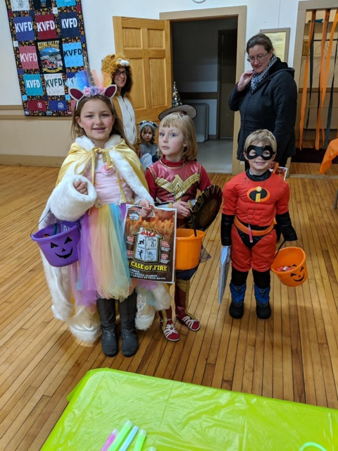 Trick or Treaters enjoying a chance to warm at the Halloween Open House Safe Place
