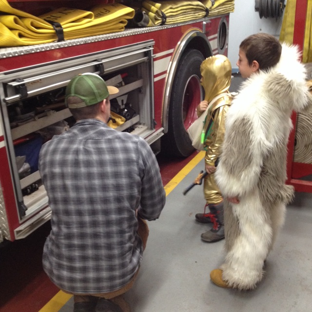 Curious Trick or Treaters  getting a tour of the Fire House during the KVFD Halloween Open House Safe Place