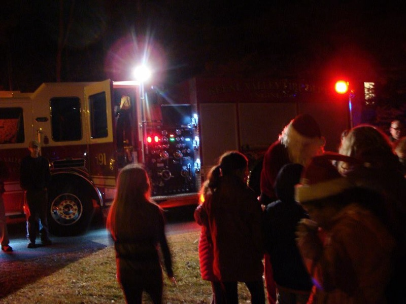 Fire Fighters bring Santa to The Neighborhood House