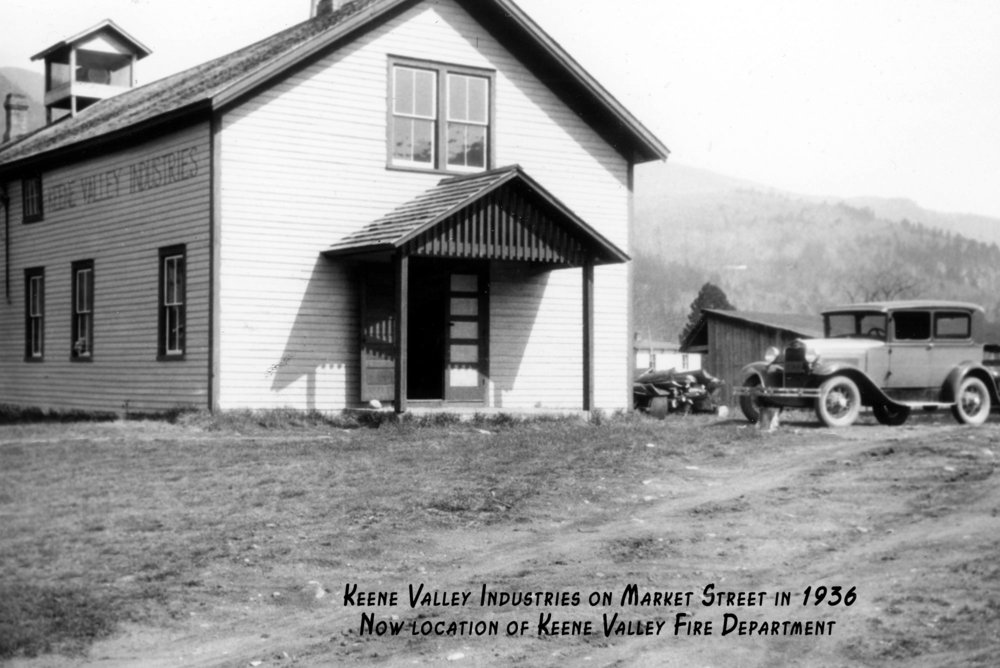 Now the KVFD fire station, the structure first served as an opera house then the Eagle Garage and in the loft above,  Keene Valley Industries  where craftsmen made furniture and interior woodwork for summer camps and cottages.
